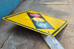 Broken traffic light sign on footpath Royalty Free Stock Photography