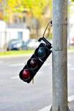 Broken traffic lights pole Stock Image