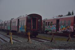 Broken train compartments with graffiti. Vandalism Royalty Free Stock Images
