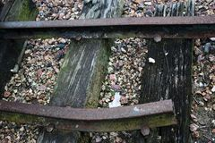 Broken train track with gravel royalty free stock image
