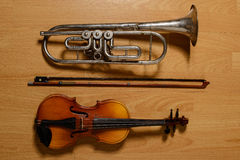 Broken trumpet and violin on the wooden floor Royalty Free Stock Images