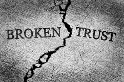 Broken Trust Illustrated with Cracked Concrete stock photography