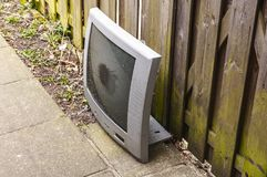 A dumped TV screen standing on the ground stock photos