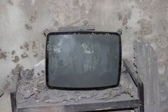 Broken tv set after volcano eruption. Remains of a village after volcano Merapi in Indonesia erupted in 2010 Stock Photos