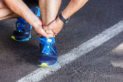 Broken twisted ankle. Running sport injury Stock Photo