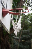 Broken and twisted basketball hoop Stock Photo