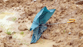 Broken umbrella after storms and floods Stock Photography