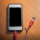 Broken usb charger cable. On wooden background Stock Image