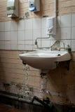 Broken and Vandalized Industrial Bathroom Sink Royalty Free Stock Image