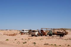 Broken vehicles in Coober Pedy, Australia. Coober Pedy is a remote opal mining town in the South Australian outback Stock Photos