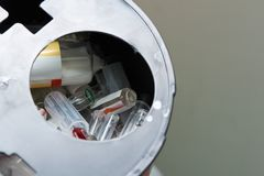 Broken vial of used drug in bioharzard container royalty free stock photo