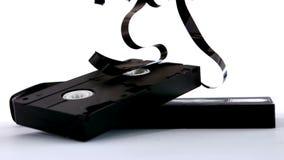 Broken video tape falling on white background Stock Image