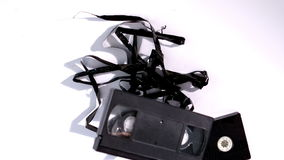 Broken video tape falling on white background Royalty Free Stock Photos