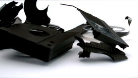 Broken video tape falling on white background Royalty Free Stock Images