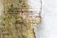 Broken vintage bricklaying wall fragment from old red clay bricks and damaged plaster frame background texture Stock Photos