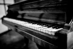 Broken vintage piano, black and white Stock Images