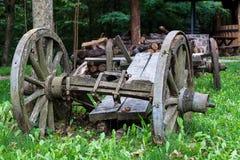 Broken vintage wooden cart Stock Photos