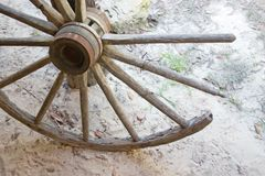 Broken wagon wheel. Detail of a vintage wooden spoked wagon wheel Royalty Free Stock Image