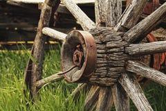 Broken Wagon Wheel in Bannack, MT. Wagon wheel on a broken down wagon in the ghost town of Bannack, MT Royalty Free Stock Photos