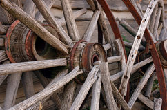 Broken Wagon Wheels. Leaning against wall stock photos