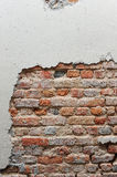 Broken wall with red brick Stock Image