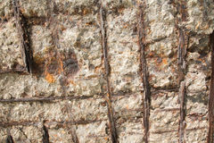 Broken wall showing the rusty steel bars Royalty Free Stock Photography