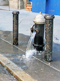 Broken Water Pipe. Water pipe bursts on 57th Street in NYC, flooded the street with water stock images