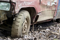 Broken wheel. Of old pick-up car stand on the ground royalty free stock photography