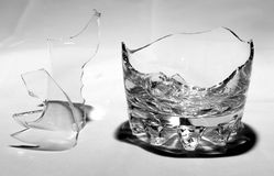 Broken whiskey glass with shrapnel Royalty Free Stock Image