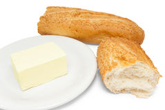 Broken white bread and butter Stock Photo