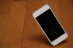 Broken white cellphone royalty free stock photos