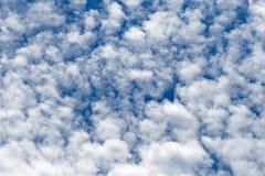 PATCHY WHITE CLOUD AGAINST BLUE SKY. Broken white clouds against blue sky Stock Images