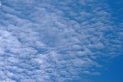 WHITE PATCHY CLOUDS. Broken white clouds against blue sky Stock Photography