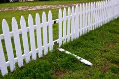 Broken White Picket Fence. In need of repair Royalty Free Stock Photos