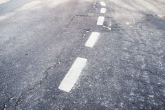 Broken white separation line on road stock photo