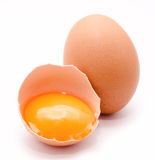 Broken and whole chicken eggs with yolk isolated Stock Photography