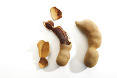 Broken and whole Tamarind pods Royalty Free Stock Photography