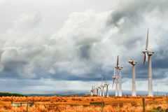 A broken wind farm under gloomy sky Royalty Free Stock Image