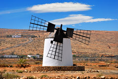 Broken windmill. Windmill with broken wing. Agriculture crisis concept. Spain Stock Photography