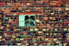 Broken window. In red brick wall Royalty Free Stock Photo