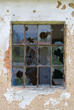 Broken window. In a old deserted house stock photography
