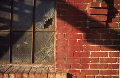 Broken Window. Shot from beneath a fire escape looking up Stock Image