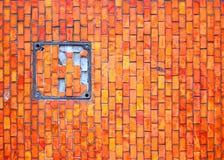 Broken Window. Broken abandoned grungy mosaic tiling Stock Photo