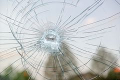 Broken window. Close up from a broken window royalty free stock photography