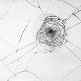 Broken window. Glass with cracks stock photography