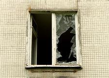 A broken window. Of an abandoned building Royalty Free Stock Photography