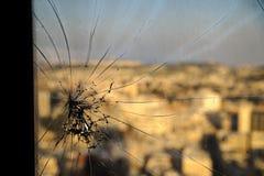 Broken window. Cracked glass on urbanic background Royalty Free Stock Photos