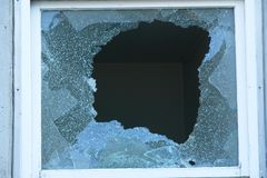 Broken Window. With very sharp glass fragments royalty free stock images