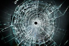 Broken window. With a bullet hole in the middle royalty free stock images
