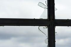 Broken window. Detail of destroyed house - cracked window stock images